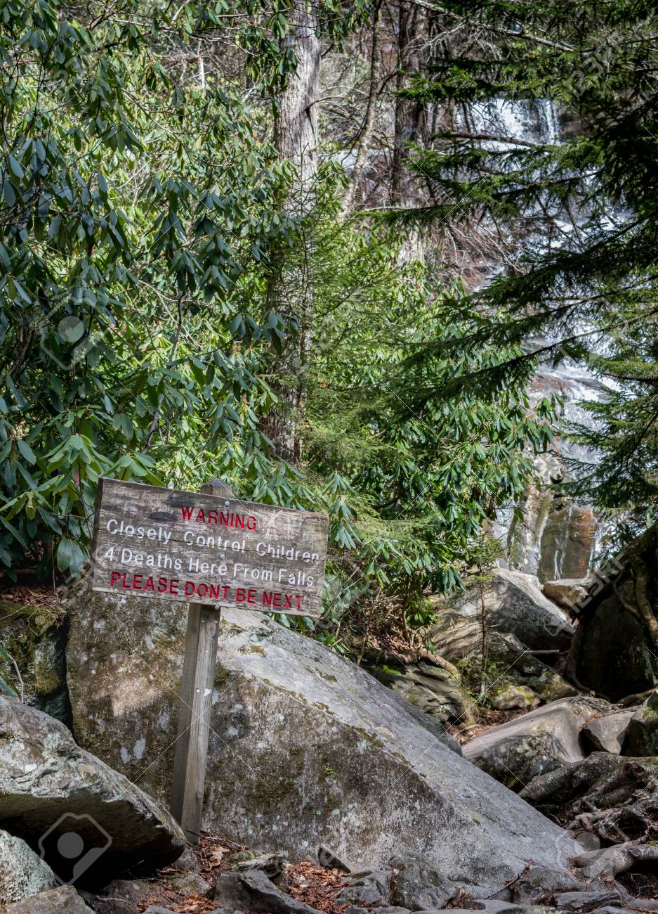 Warning Sign And Ramsey Cascade In Background In Smokies Stock 937x1300