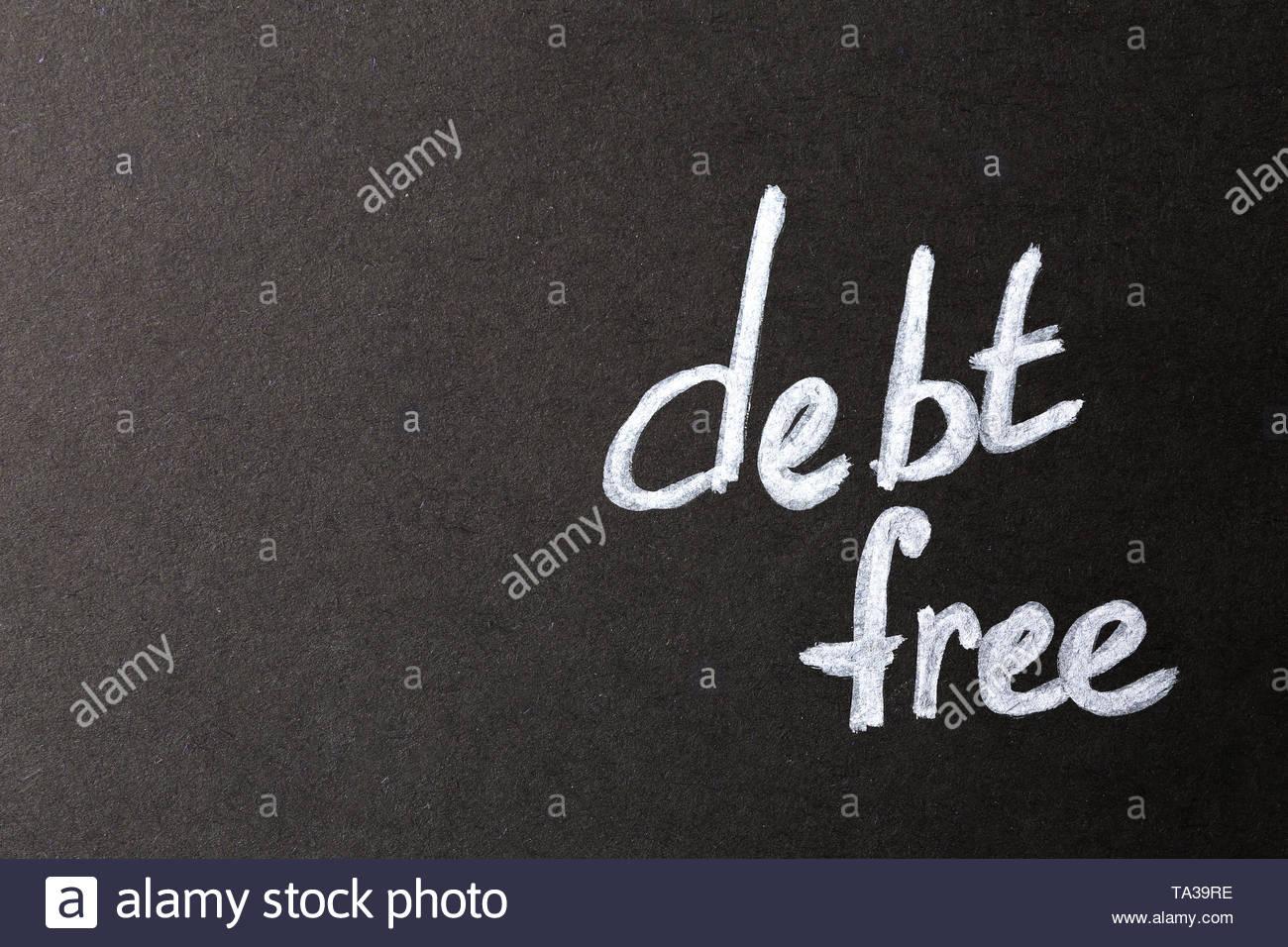 Text DEBT FREE on dark background Stock Photo 247165282   Alamy 1300x956