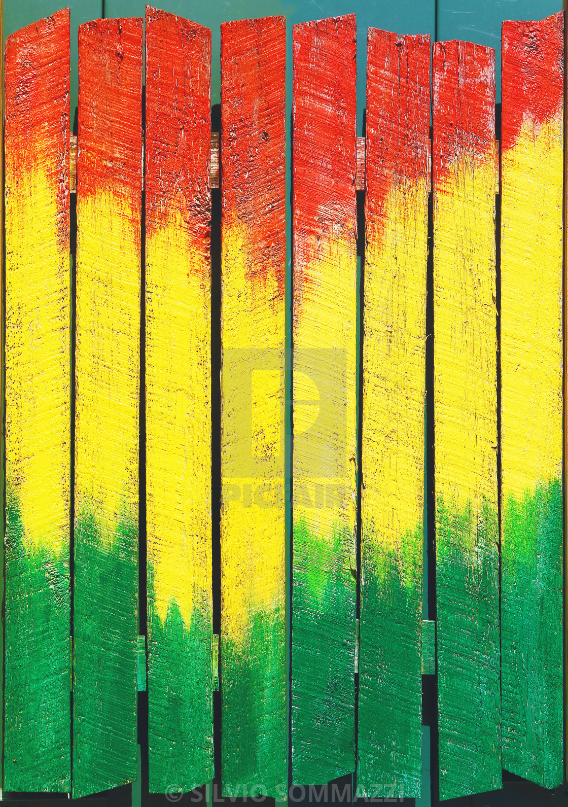 Jamaican background painted on fence   License download or print 1120x1591