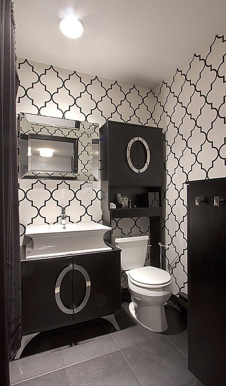 Bold graphic wallpaper is perfect for a small bathroom Design by 450x768