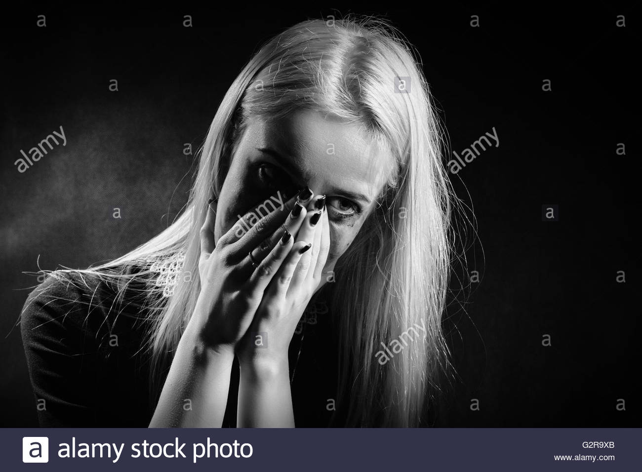 sad shocked girl crying on black background monochrome image 1300x956