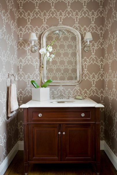 beige and white small half bathroom under stairs wood furniture vanity 406x608