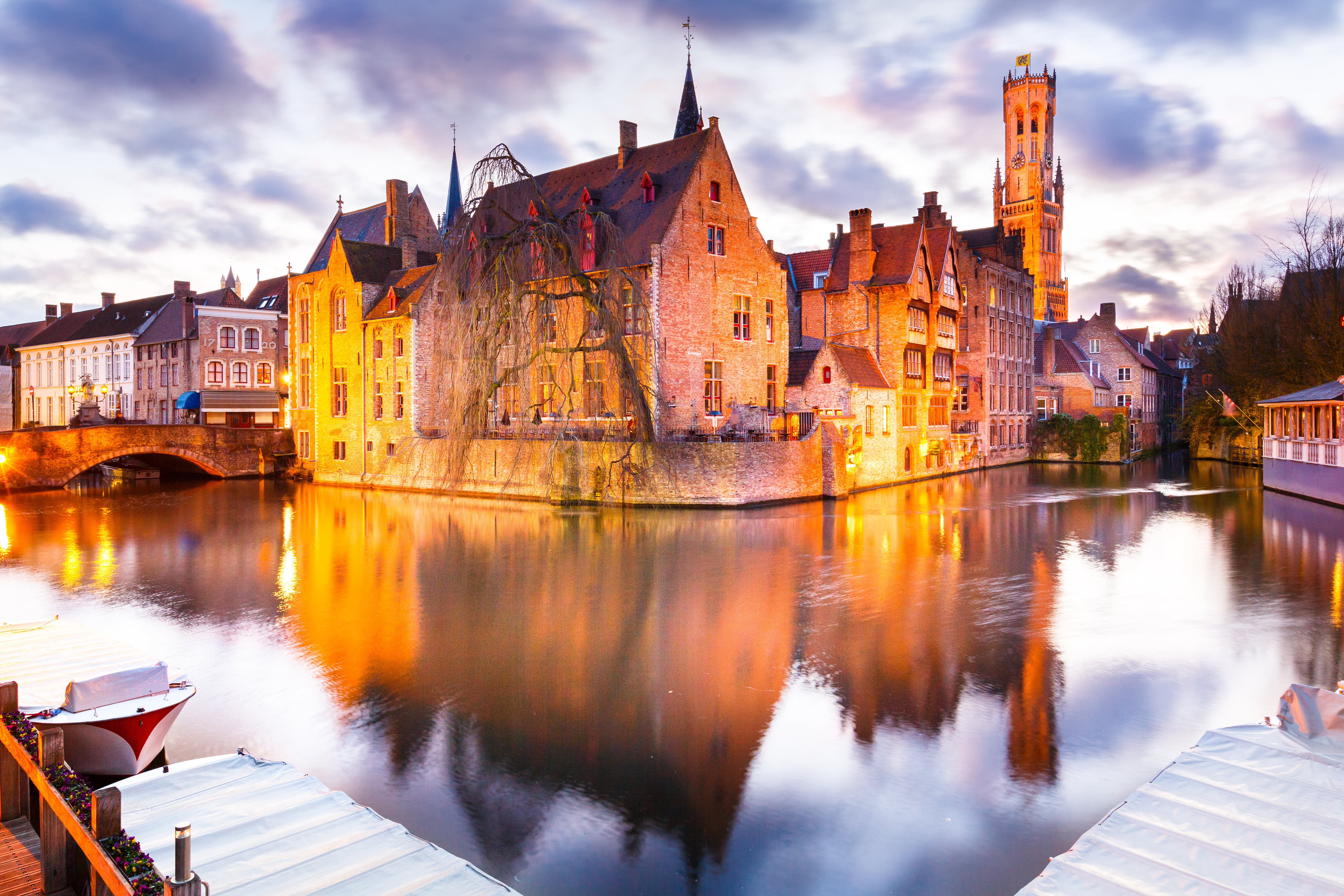Concrete house beside body of water with bridge brugge HD 5101x3401