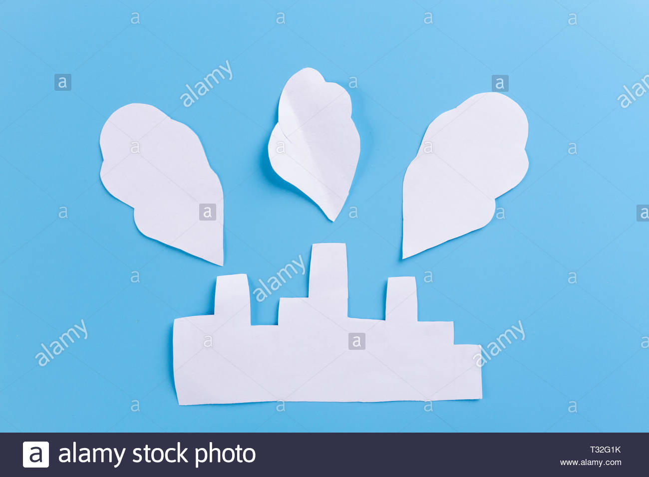 paper factory on blue background environmental pollution concept 1300x956