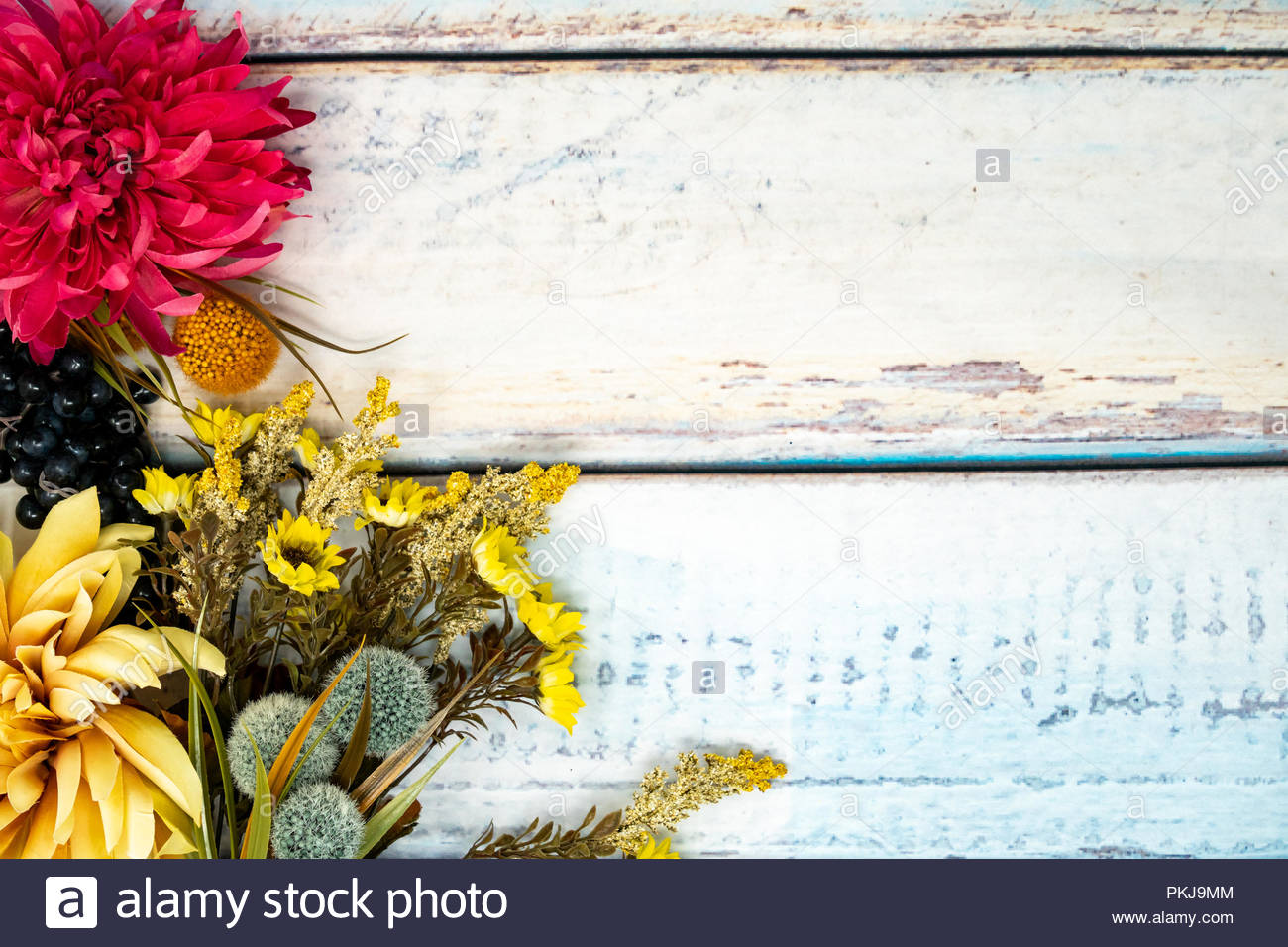 Pretty fall background on a wooden backdrop Fall flowers mums 1300x956