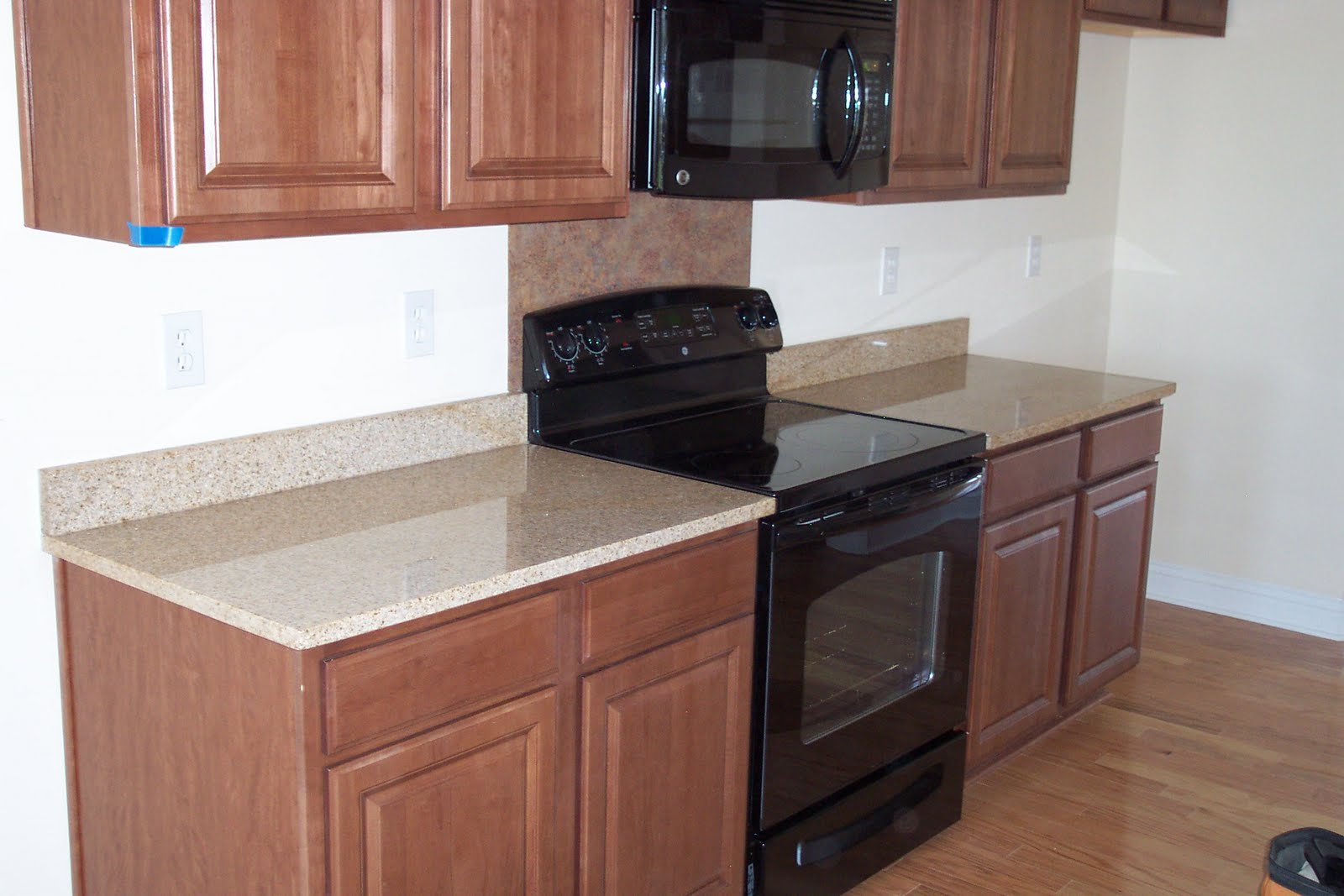 Granite kitchen countertops price per foot wallpaper for Corian countertops cost per sq ft
