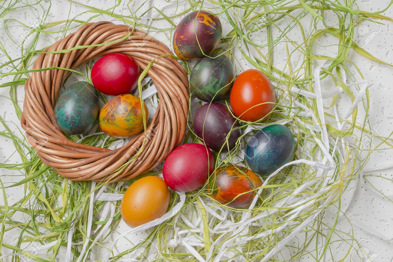 Colorful Easter Eggs On White Background And Raffia Stock Photo 1300x866