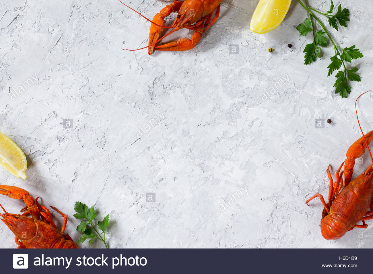 Boiled crawfish lemon and parsley on a concrete background Food 1300x956