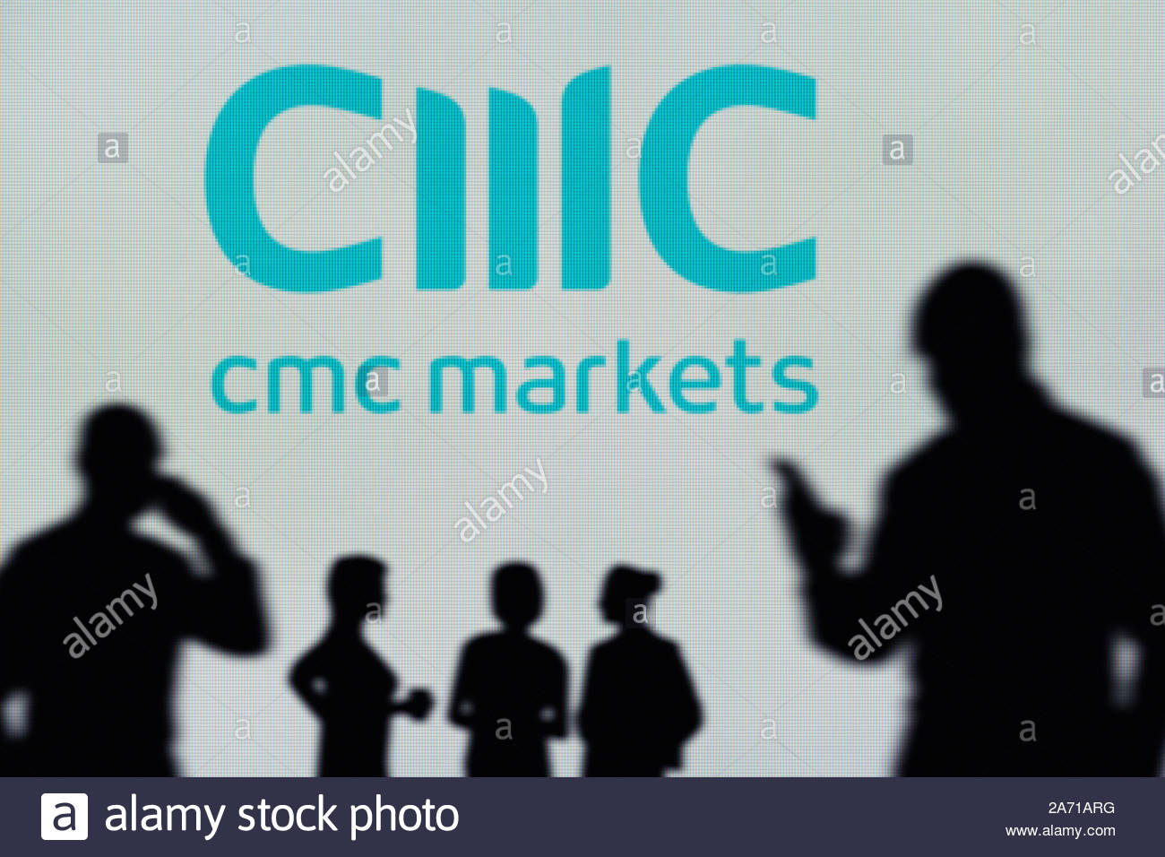 The CMC Markets logo is seen on an LED screen in the background 1300x956