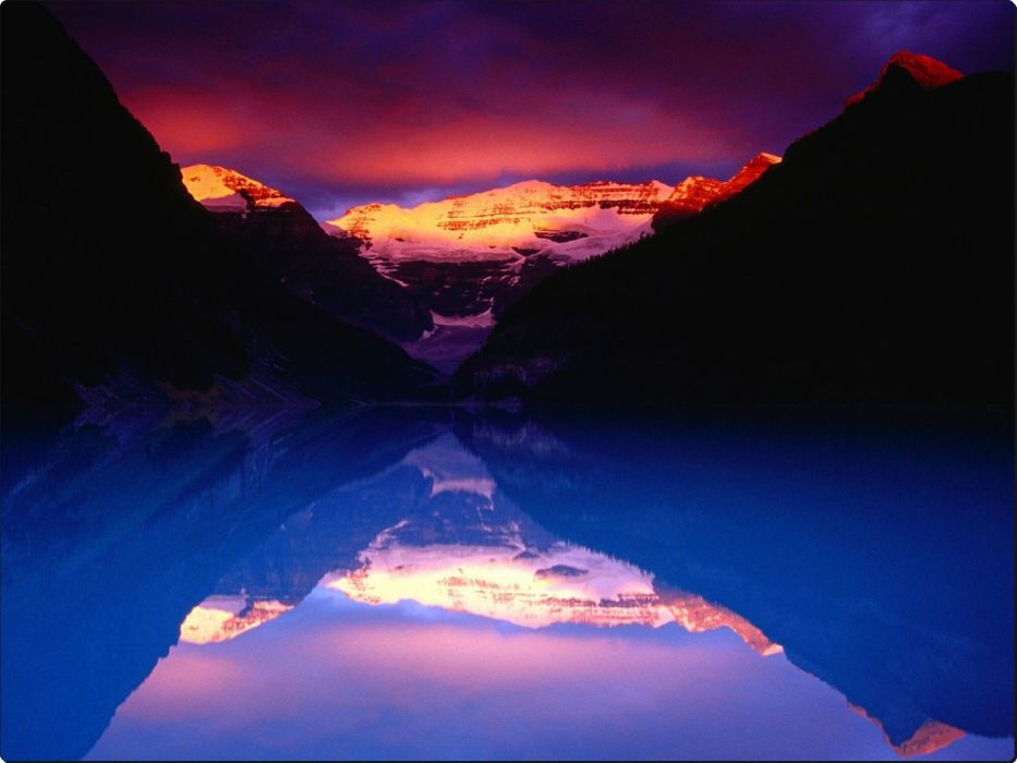 Stormy Alpenglow Lights Mount Victoria and Lake Louise Banff 933x700