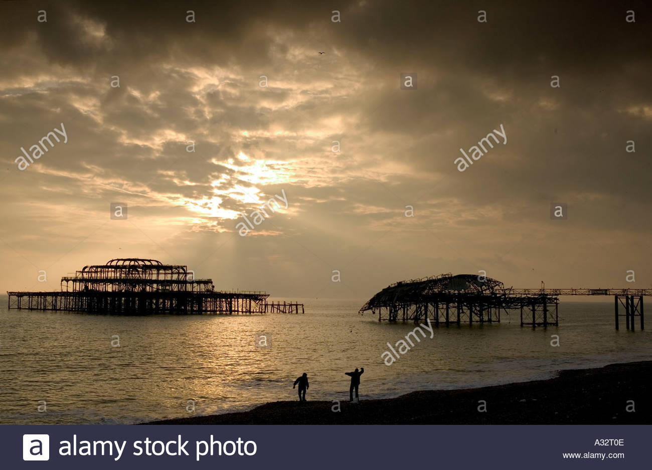 brighton seafront at sunset with the collapsed pier in the 1300x937