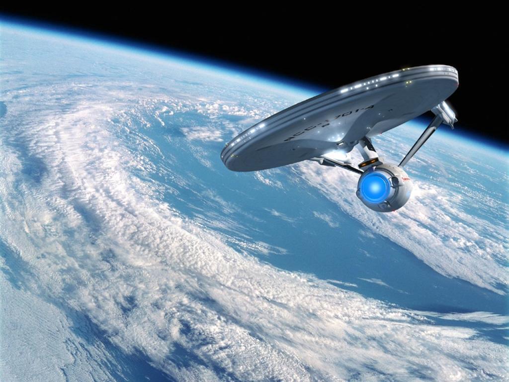 Star Trek wallpaper USS Enterprise in Earth orbit 1024x768