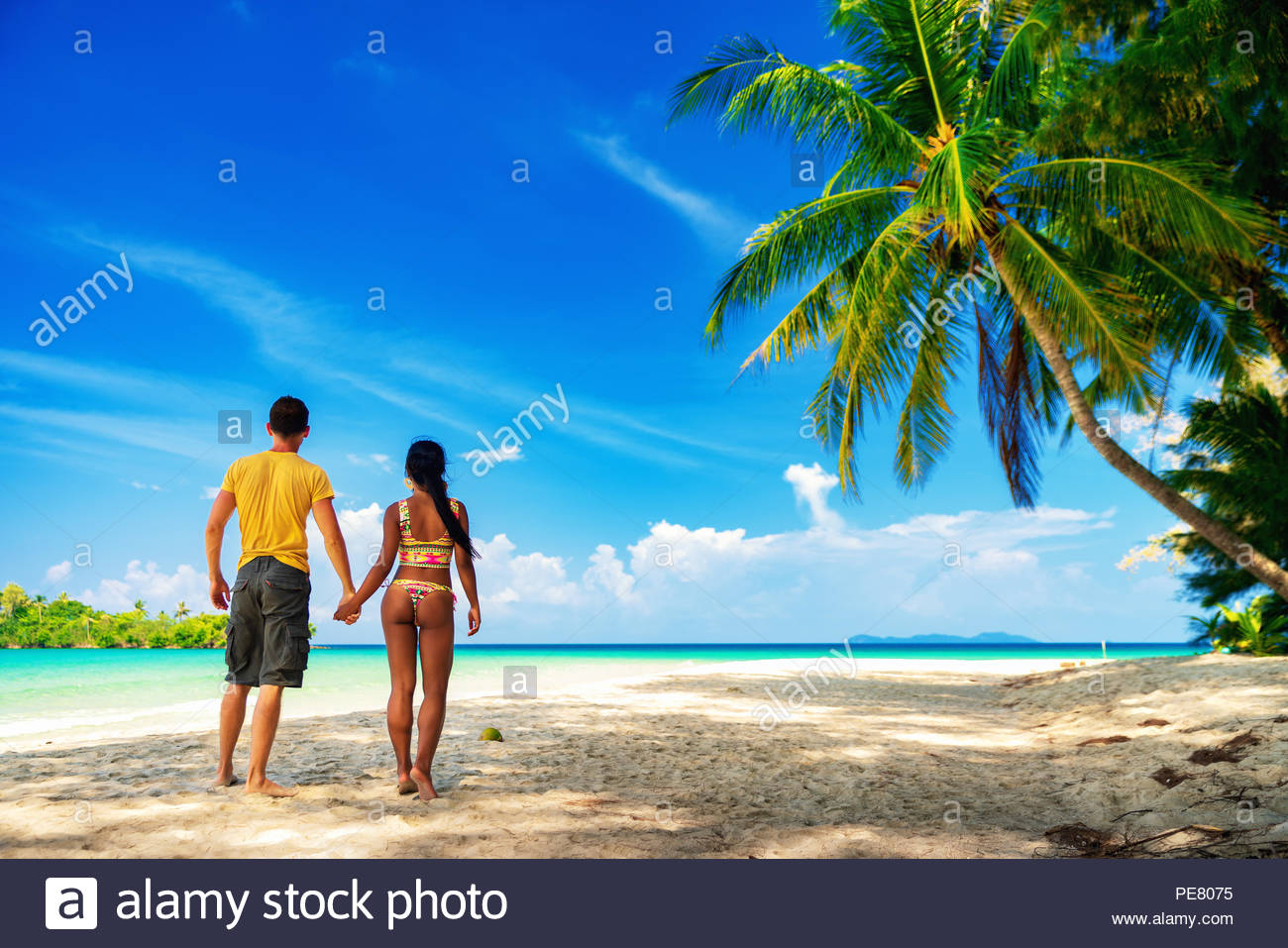 Loving couple tourist enjoy honeymoon vacation on the tropical 1300x957