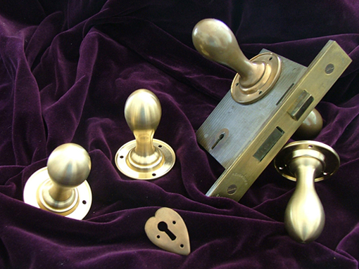 Photo of reproduction bronze door knobs designed by CFA Voysey 510x383