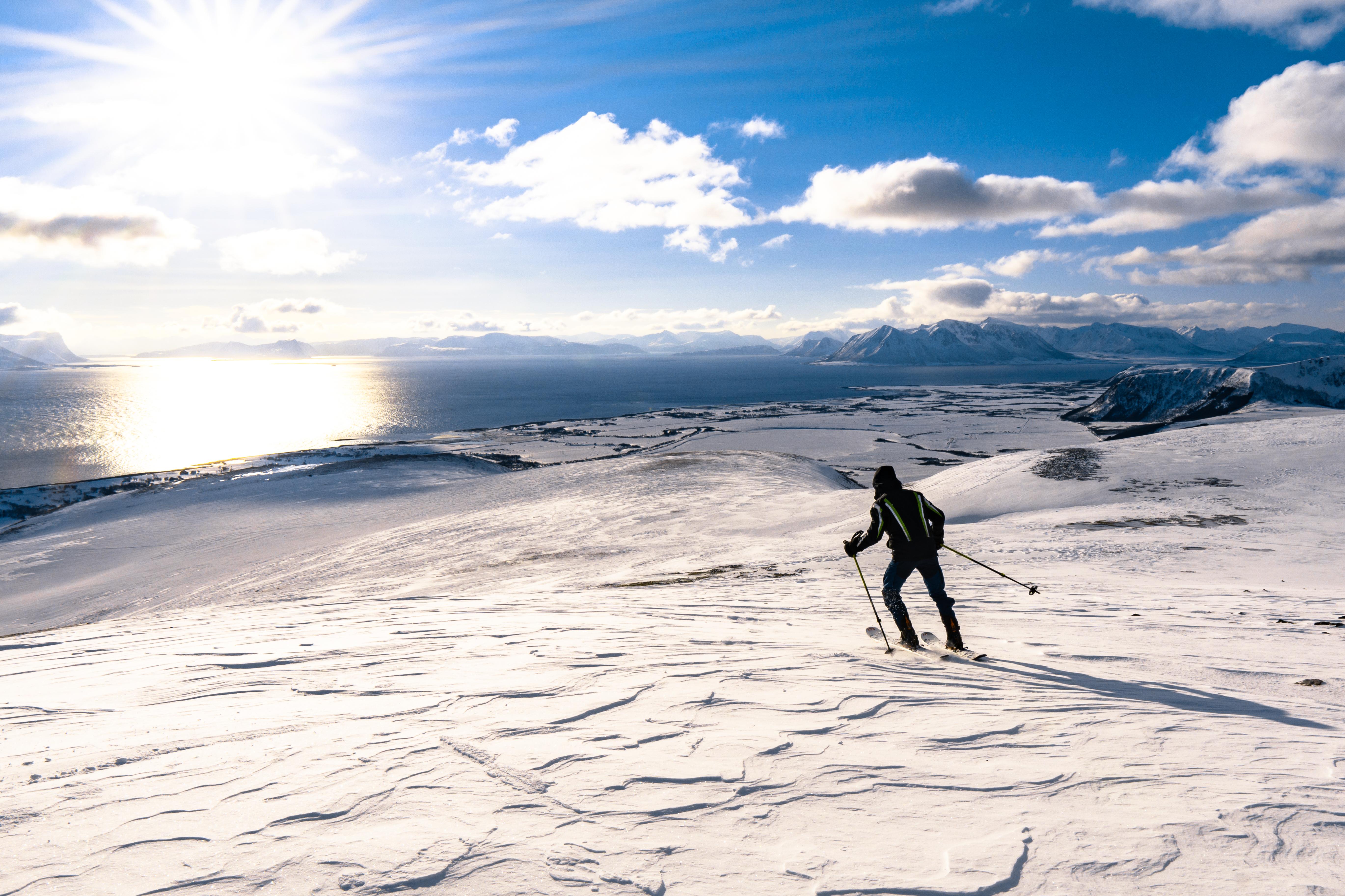 Man Skiing on Snowy Mountains of Norway Stock Photo picjumbo 5479x3653