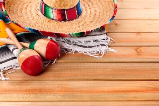 Mexican Serape Rug Sombrero And Maracas Stock Photo 507x338