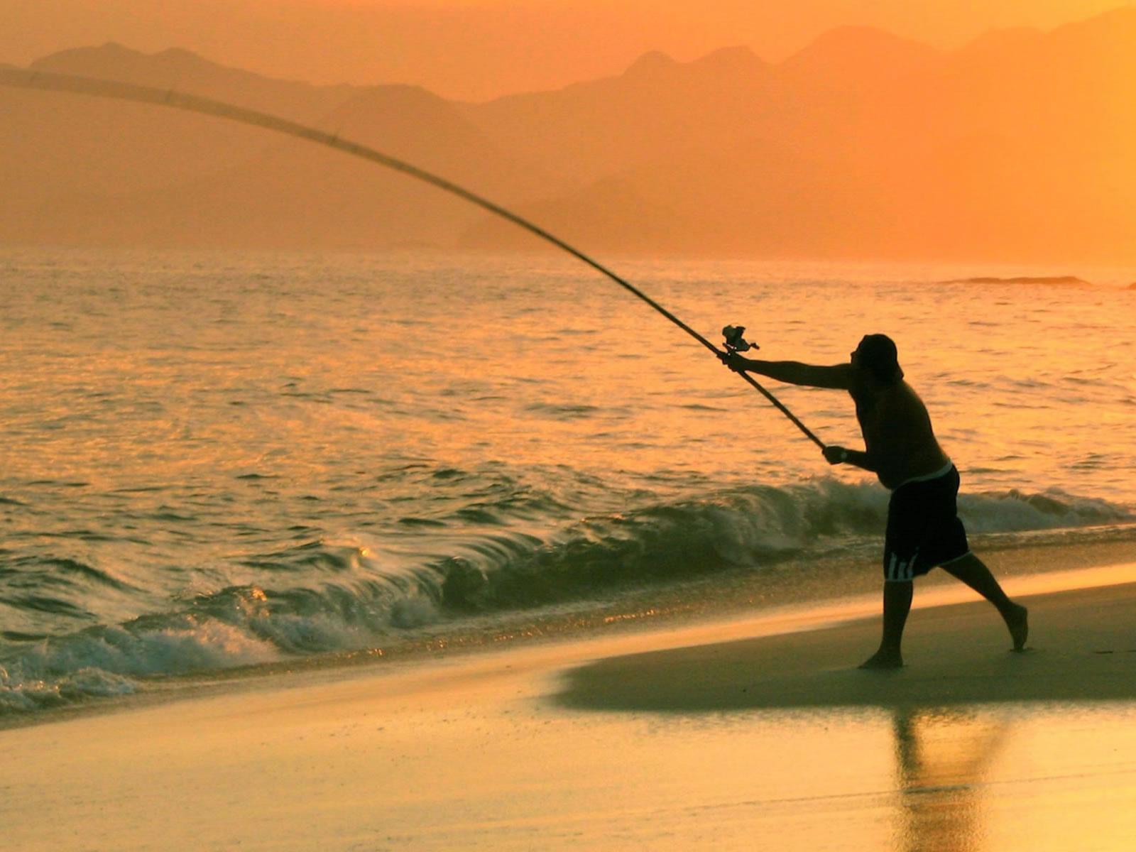1600x1200 Fishing in the sea desktop PC and Mac wallpaper 1600x1200