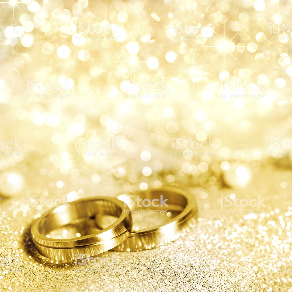 Gold Wedding Rings With Glittering Gold Background Stock Photo 1024x1024