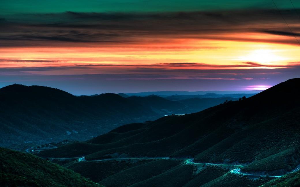 Decline Sky Hills Road Bends Turns Orange Twilight Descent 1040x650