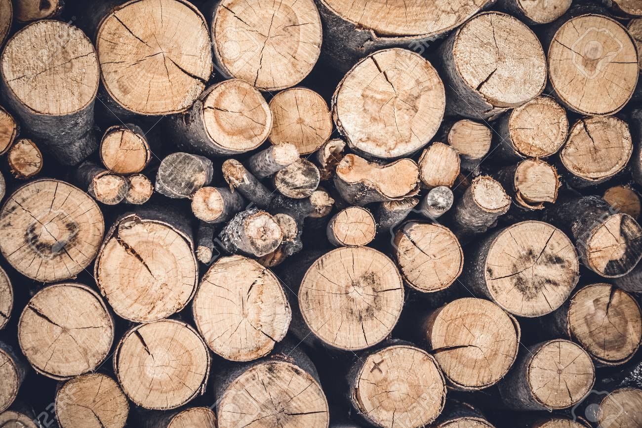 Pile Of Cut Wooden Logs Stacked Firewood Background Stock Photo 1300x866