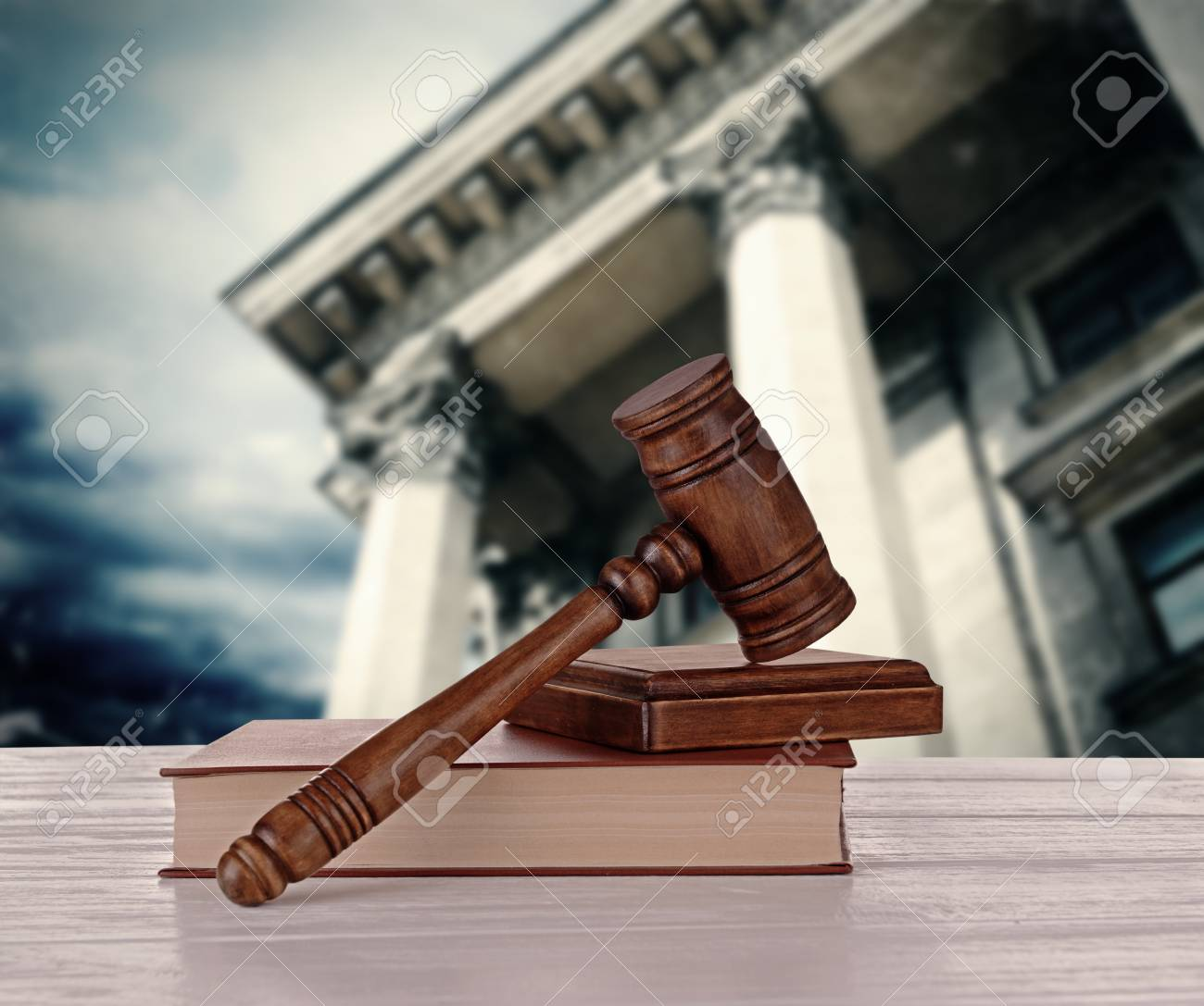 Gavel With Books On Courthouse Background Stock Photo Picture And 1300x1087
