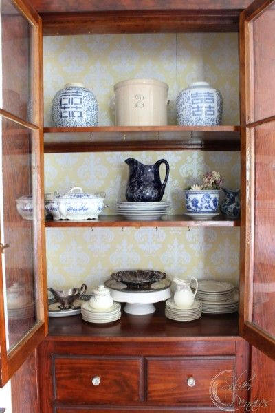 china cabinet in our dining room with Targets adhesive wallpaper 400x600
