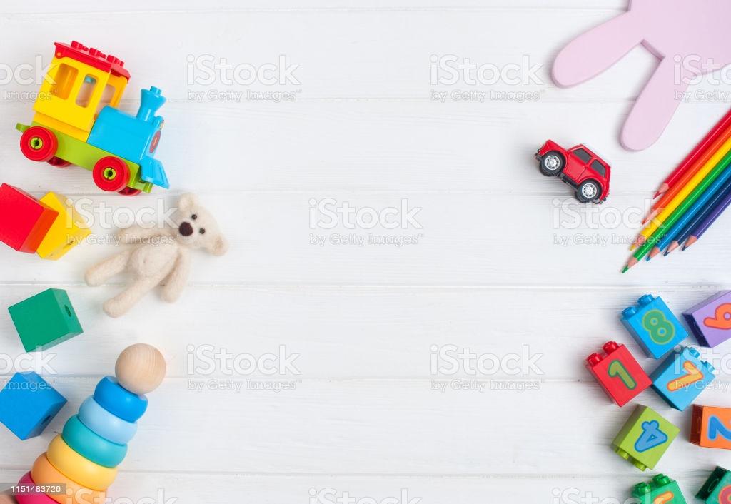 Frame Of Kids Toys On White Wooden Background Stock Photo 1024x706