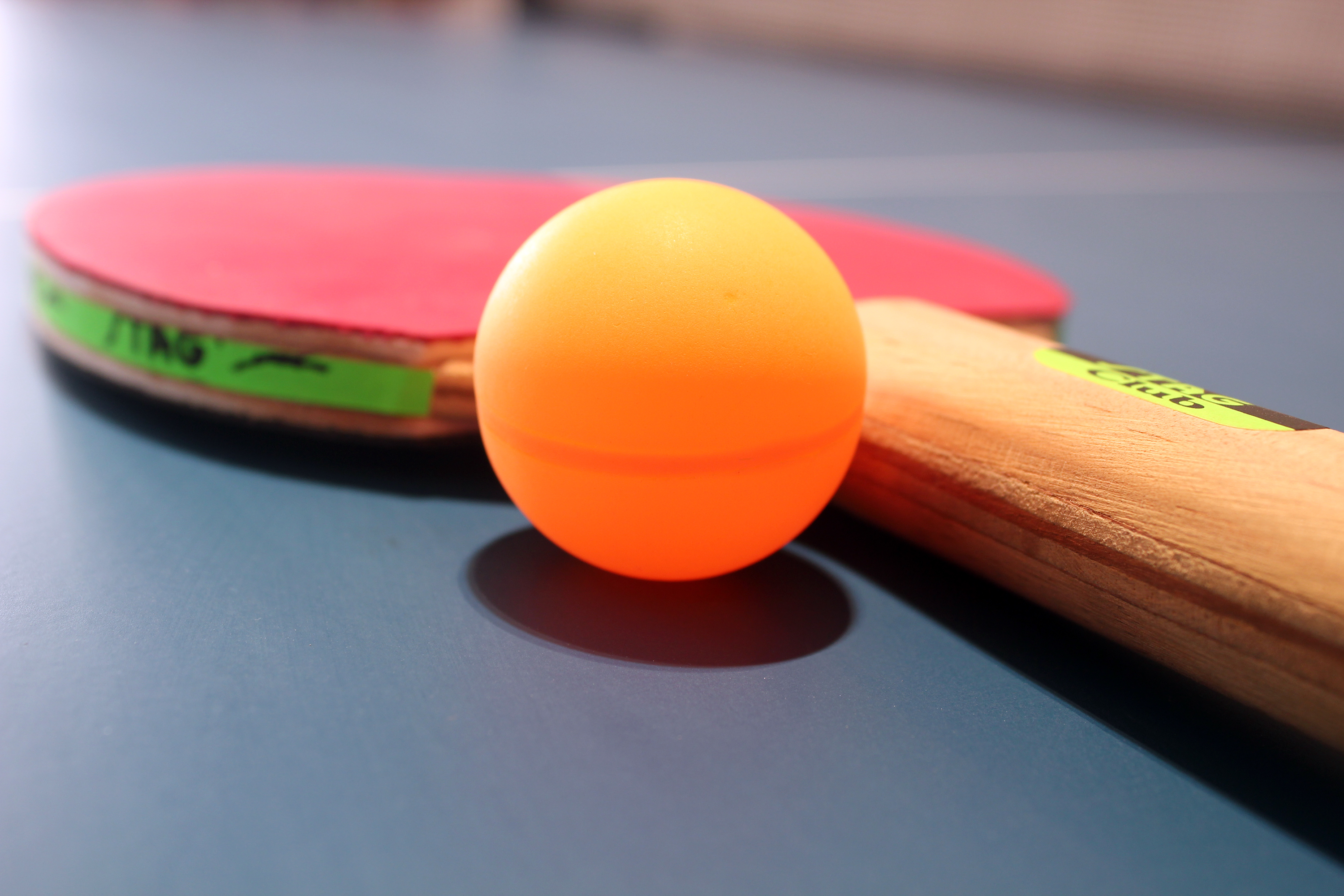 table tennis ball and racket on ping pong table f5jpg 3000x2000