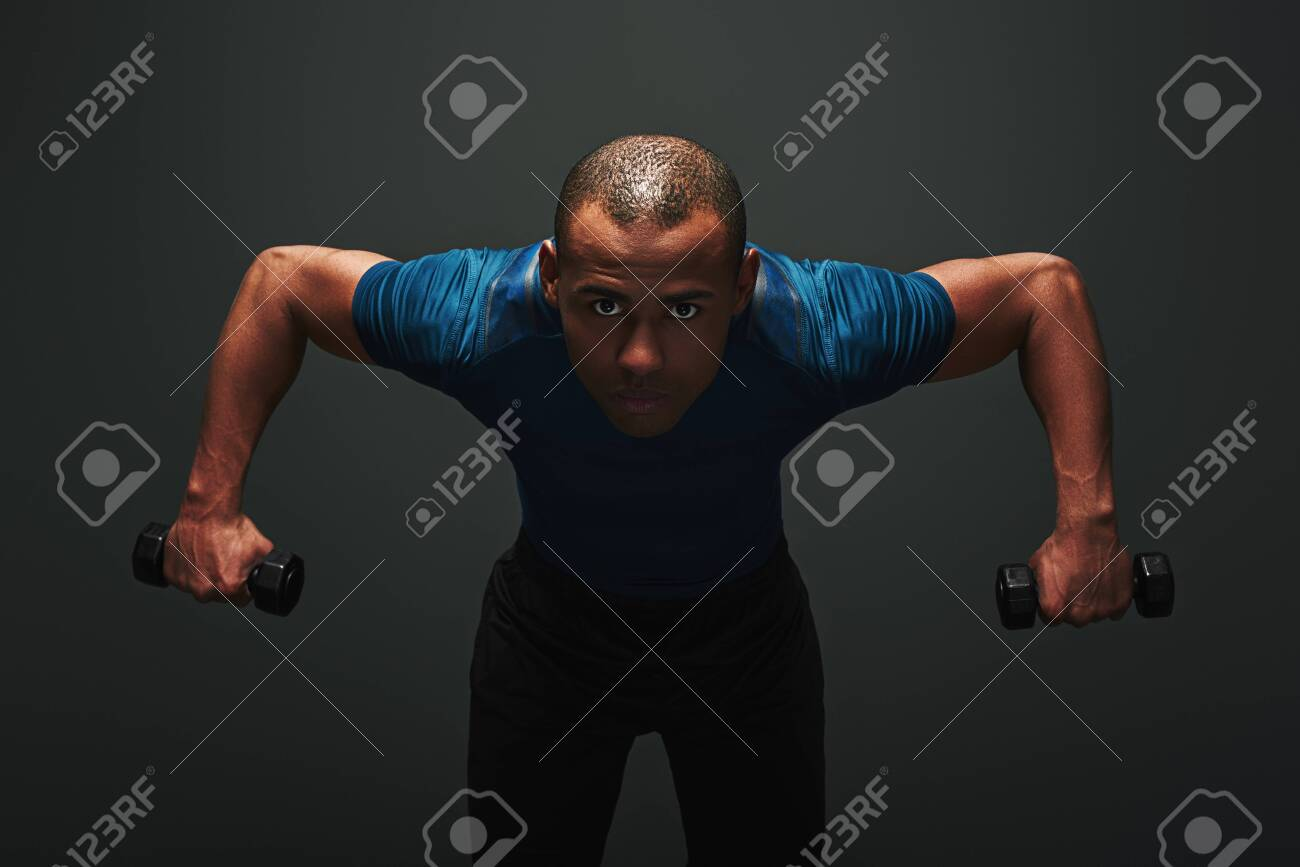 Working Hard Handsome Sportsman Sitting In Dark Background Stock 1300x867