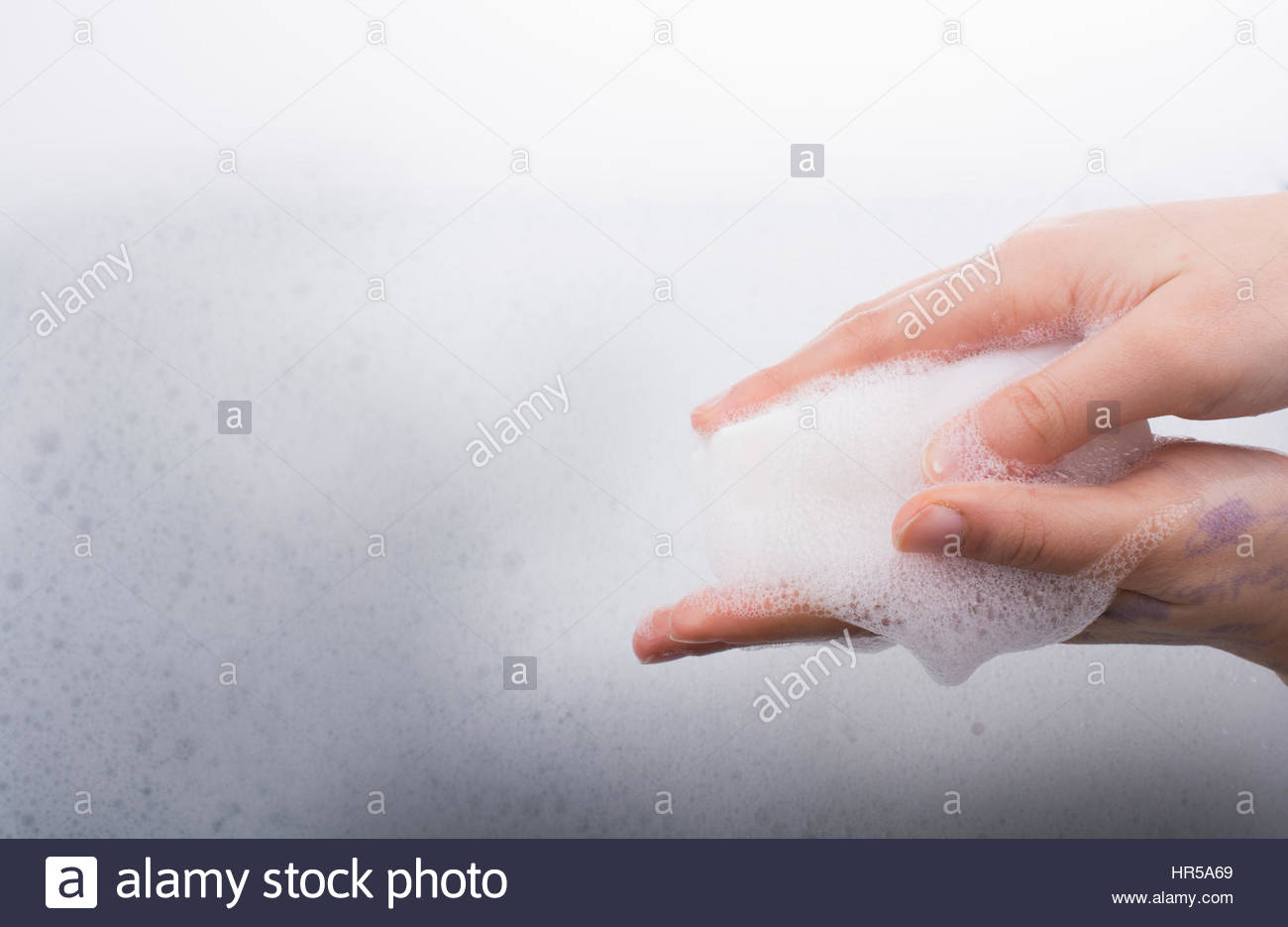 Hand washing and soap foam on a foamy background Stock Photo 1300x935