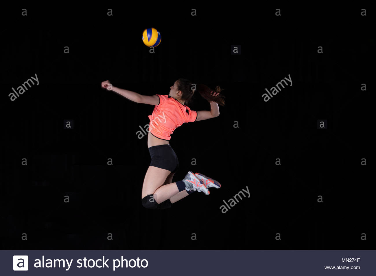 Young woman volleyball player isolated on black background Stock 1300x956