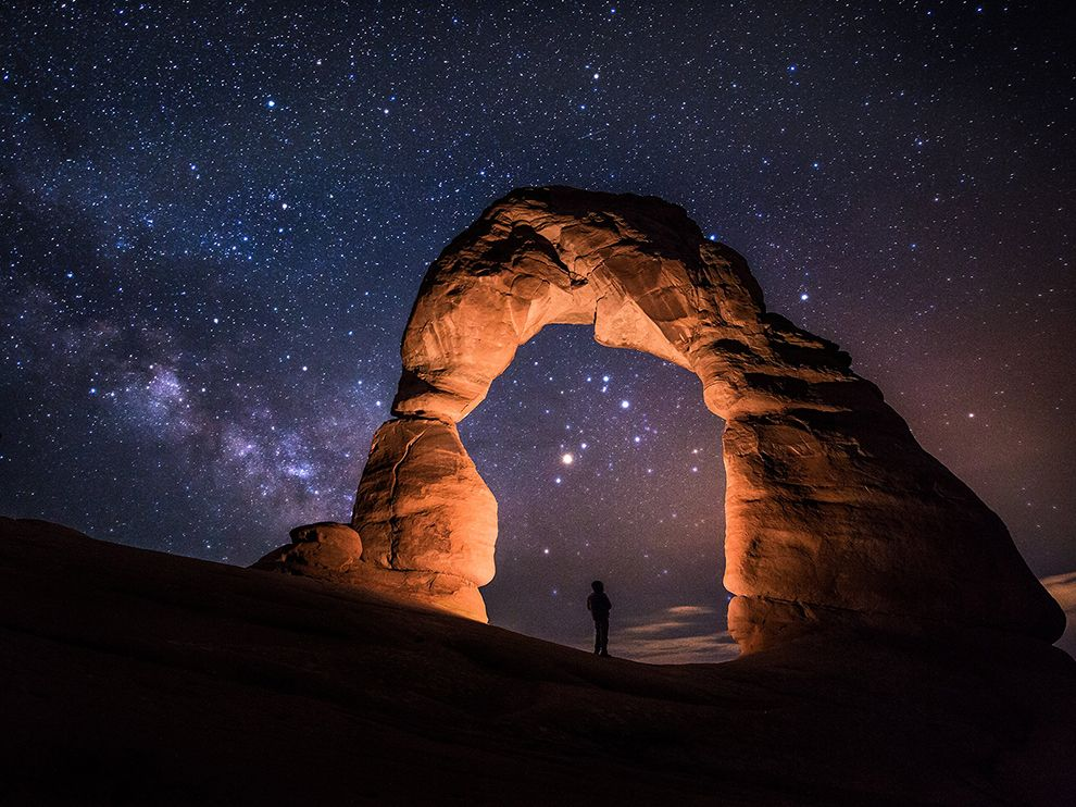 Picture of Delicate Arch lit at night in Arches National Park Utah 990x742