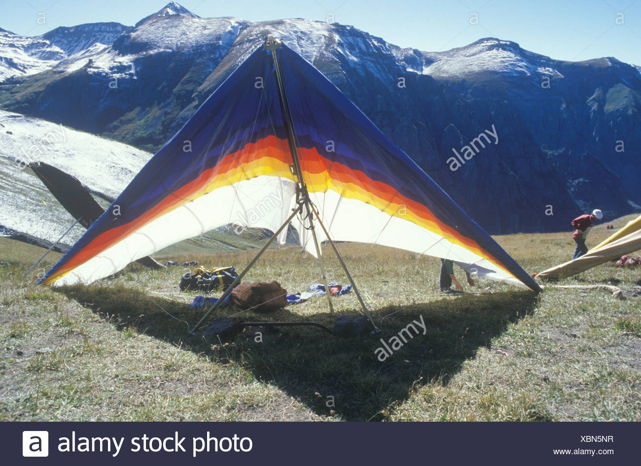 Hang glider on ground with mountains in background Hang Gliding 1300x946