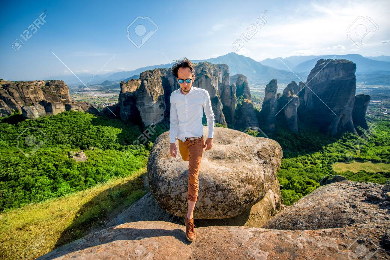 Well dressed Man Walking On The Rocky Mountain On Beautiful Scenic 1300x867