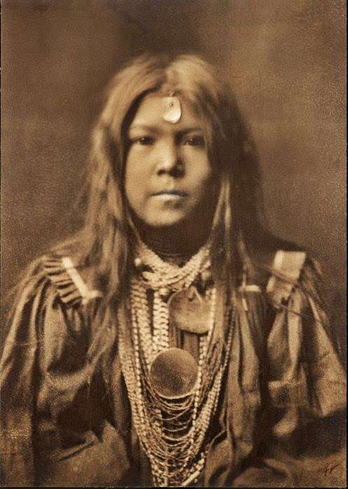 Apache Indian Girl Wearing a Bucksin Dress 497x698