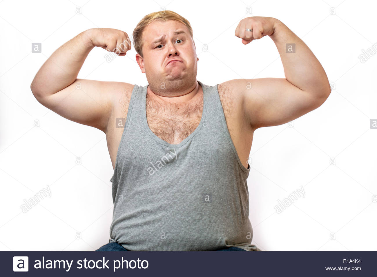 Funny overweight sports man flexing his muscle isolated on white 1300x956