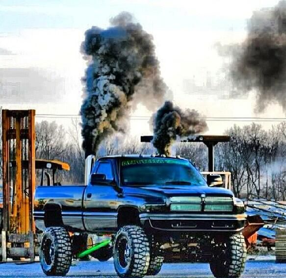 Sexy Black Second Gen Dodge Cummins Diesel Roll Coal Lifted 583x567