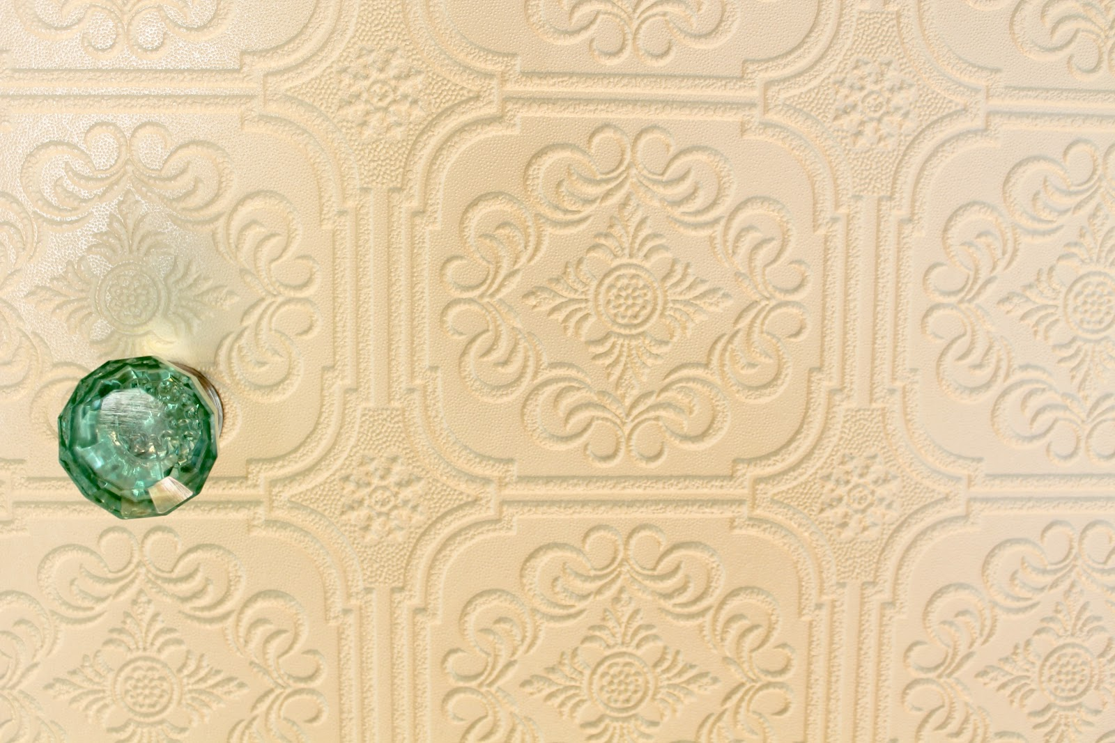 with paintable wallpaper from Lowes and added these beautiful glass 1600x1067