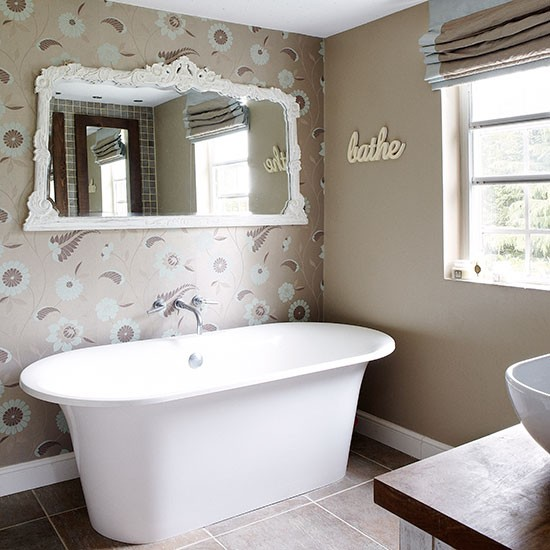 Bathroom with floral wallpaper and modern roll top bath Bathroom 550x550