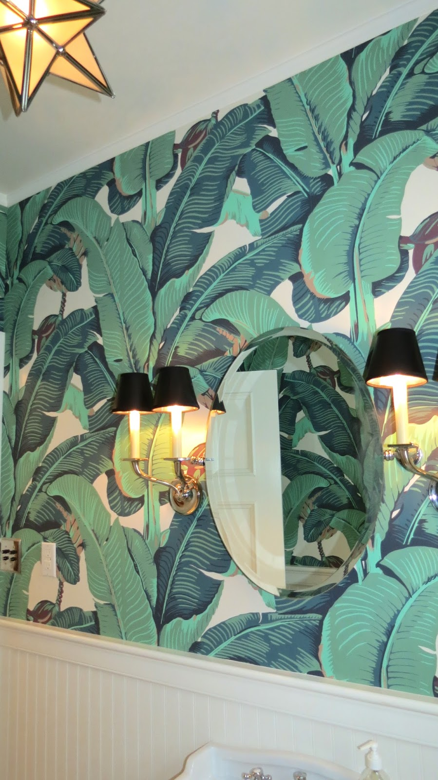 love the way the black sconce shades stand out against the cream 899x1600