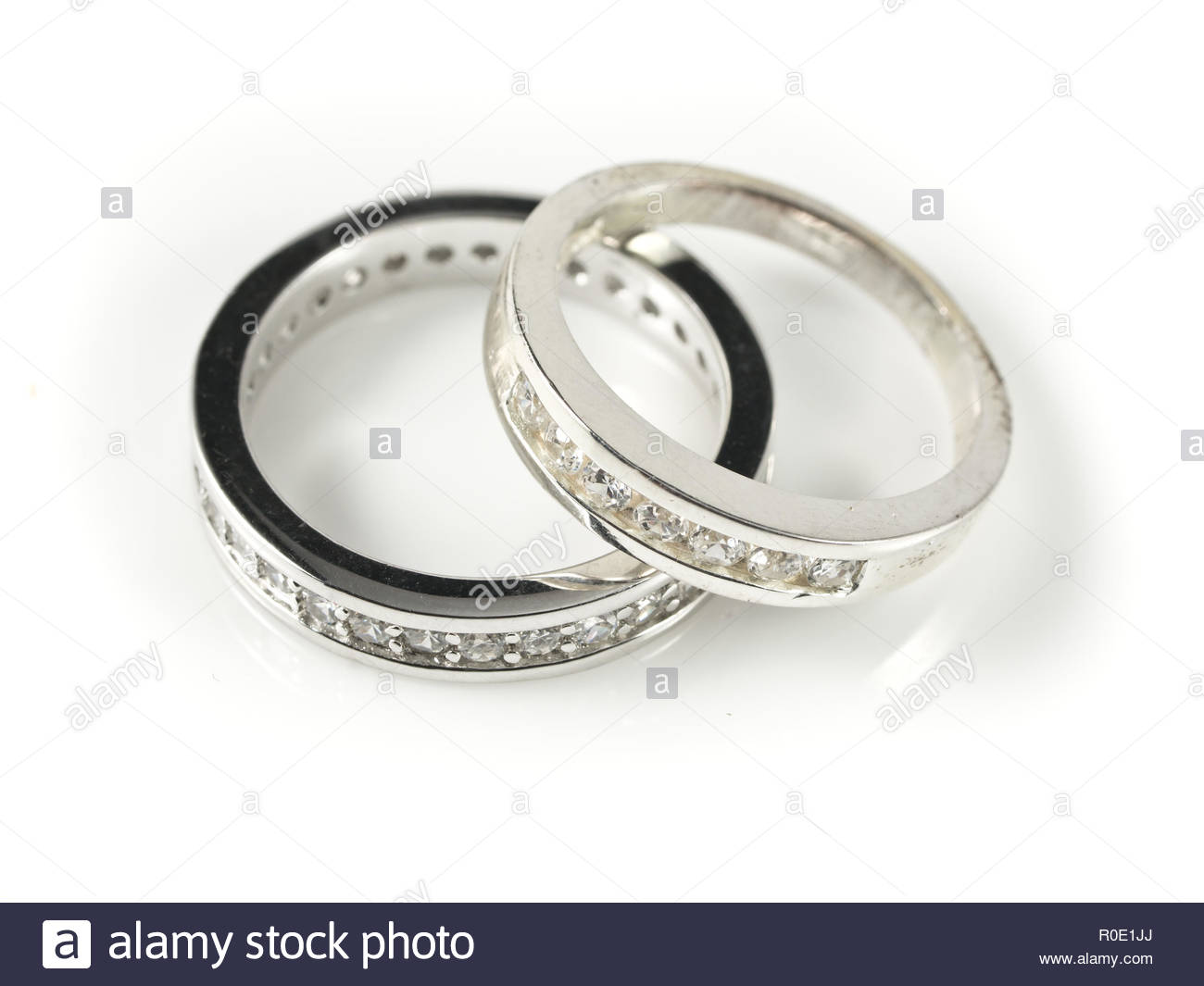 Two wedding rings on white background Stock Photo 224043418   Alamy 1300x1065