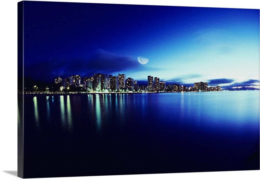 Hawaii Oahu Honolulu Waikiki skyline at night moon overhead 1000x690