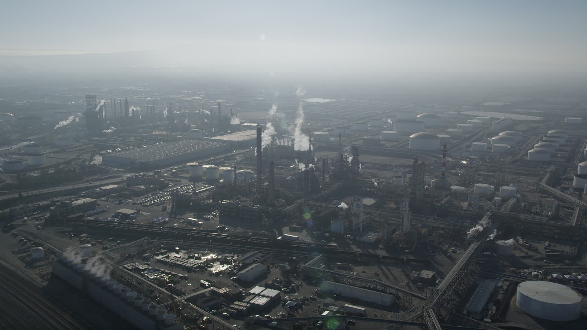 5K stock footage aerial video approach and fly over an oil 1920x1080
