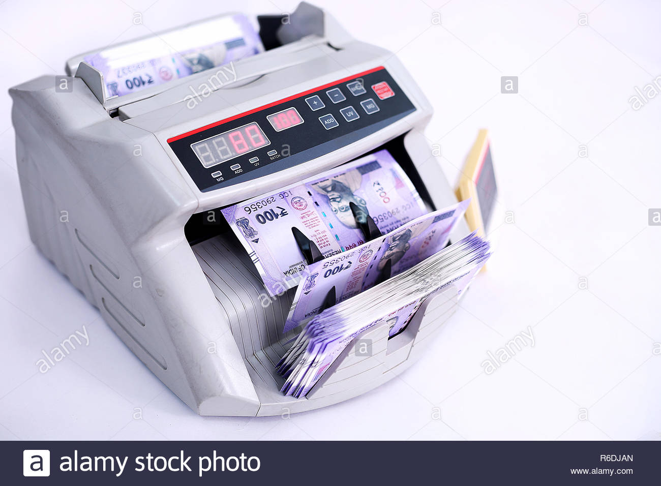 Banknote counter is counting Indian banknotes Isolated on the 1300x956