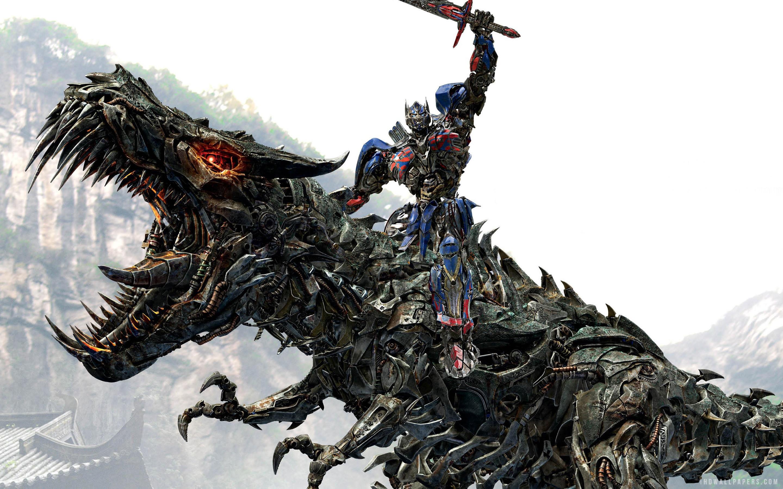 Optimus Prime Riding Grimlock in Transformers 4 wallpaper 2560x1600 2880x1800
