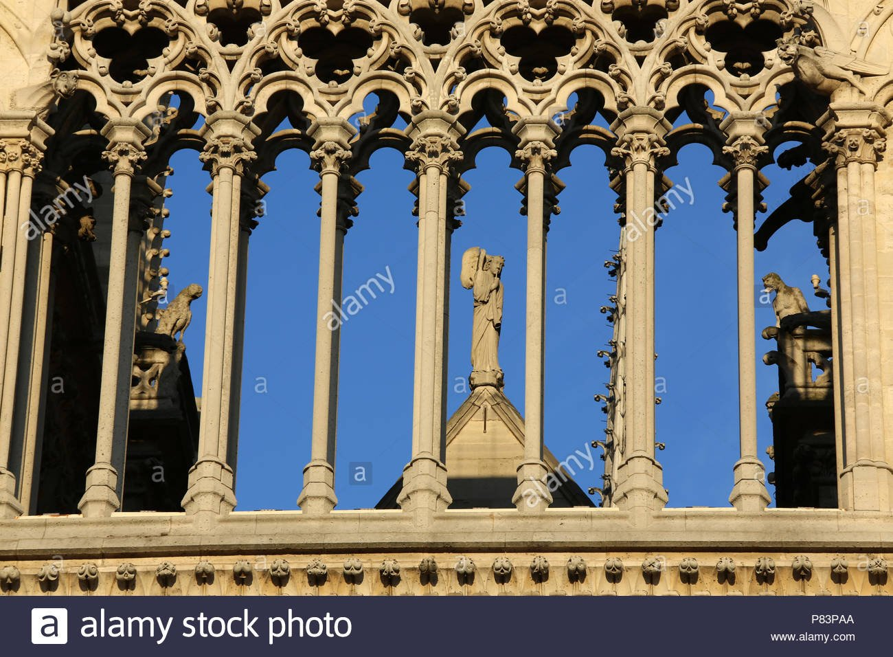 Detail of exterior columns and stone work blue sky background 1300x956