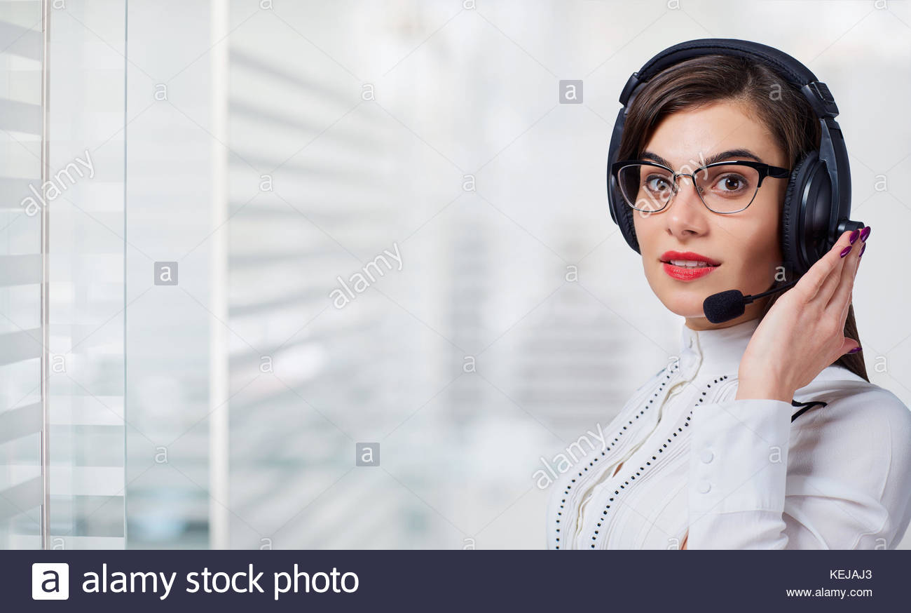 Young woman call center operator in headset on office background 1300x874