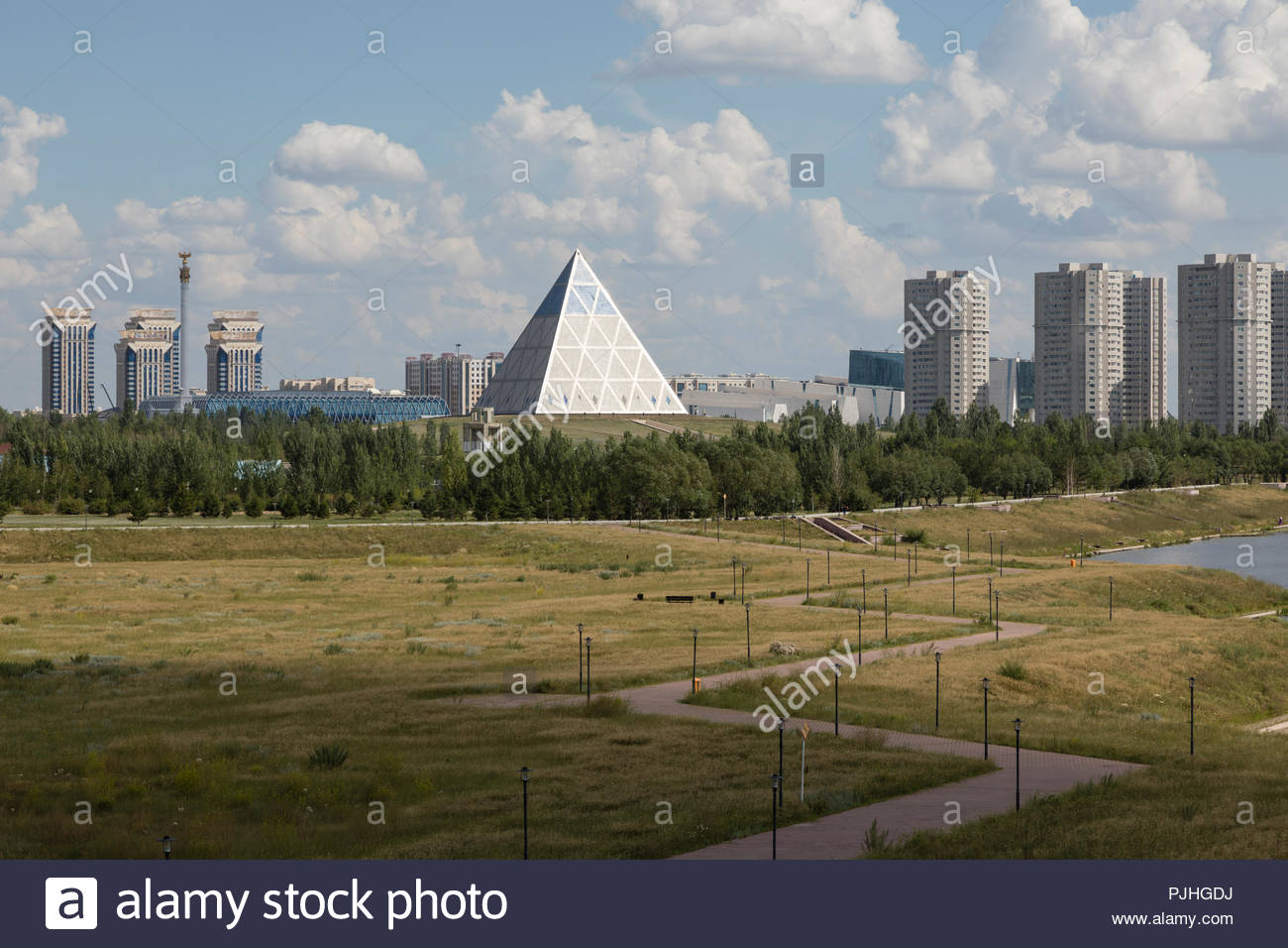 Shore of the Yesil River in Astana with the Palace of Peace and 1300x956