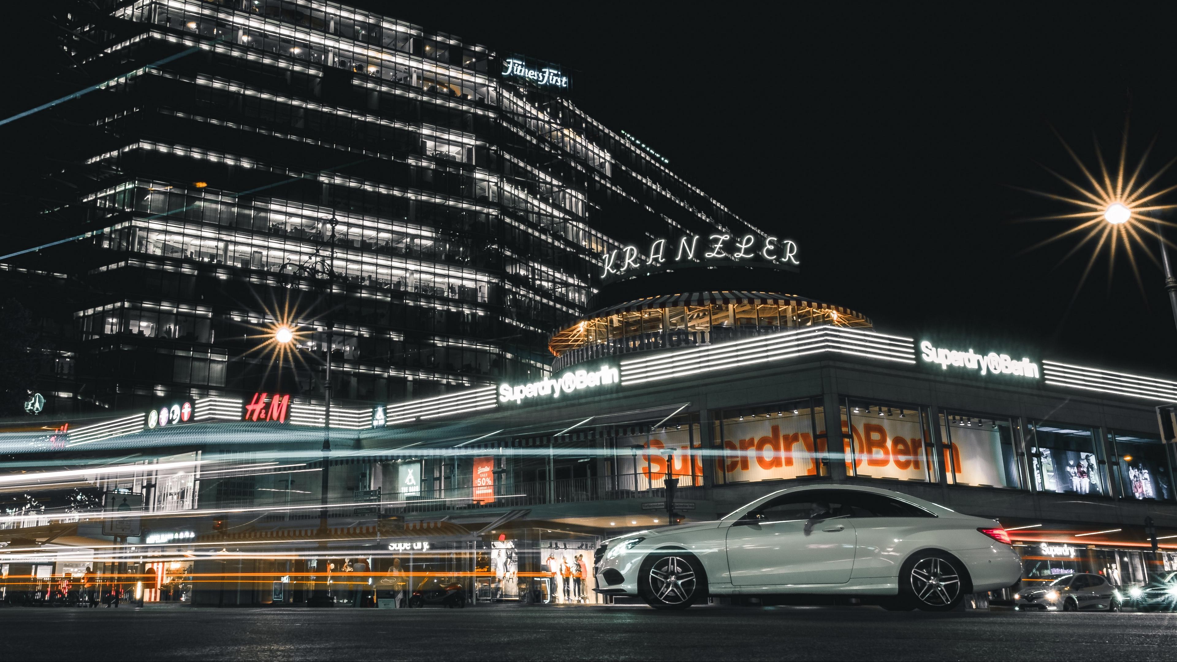 Download wallpaper 3840x2160 car night city street city lights 3840x2160