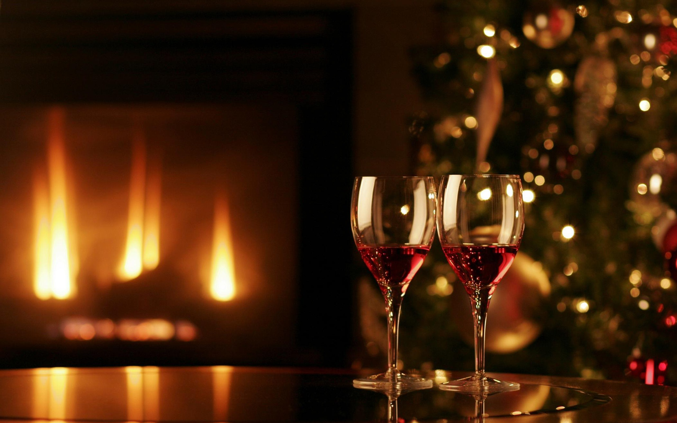two wine glasses christmas fireplace merry christmas hd wallpaper 2560x1600